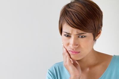 Woman with jaw pain | Botox Treatment Beachwood OH