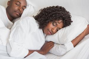 Couple sleeping peacefully after sleep apnea treatment in Beachwood, OH